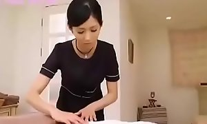Japanese brown performs massage with an increment be proper of handjob
